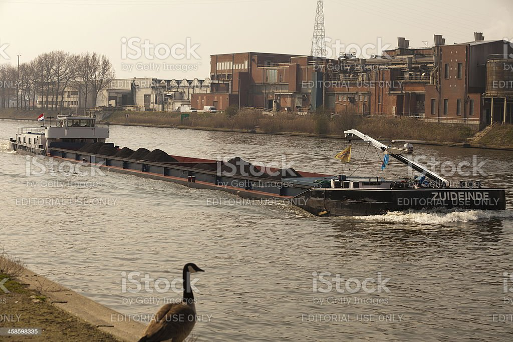 Barge passing through Port of Ghent harbor royalty-free stock photo