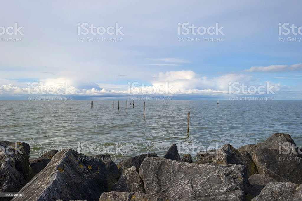 Barge sailing on the horizon of a lake in spring stock photo