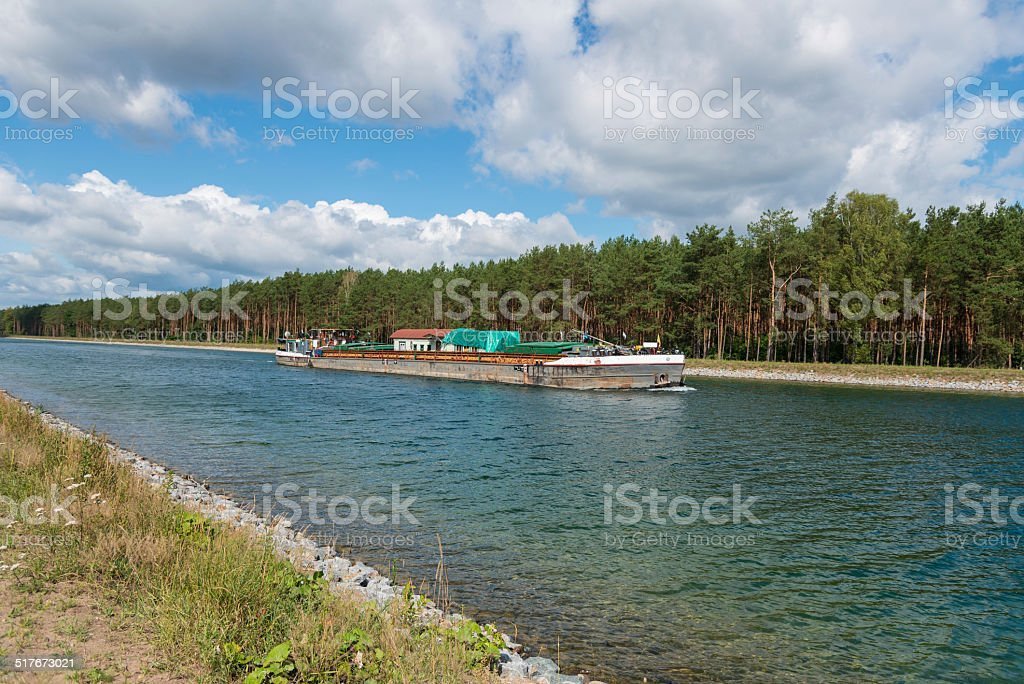 Barge ship at the Havel canal to the ship lift stock photo
