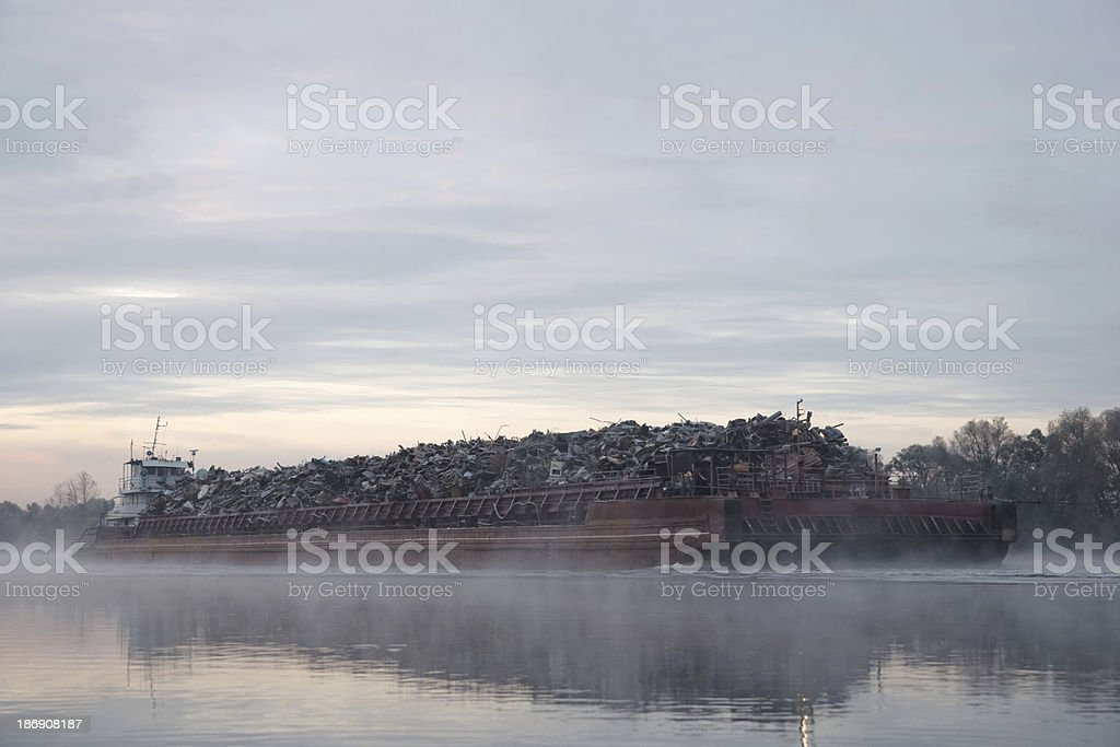 Barge ship loaded with scrap metal royalty-free stock photo