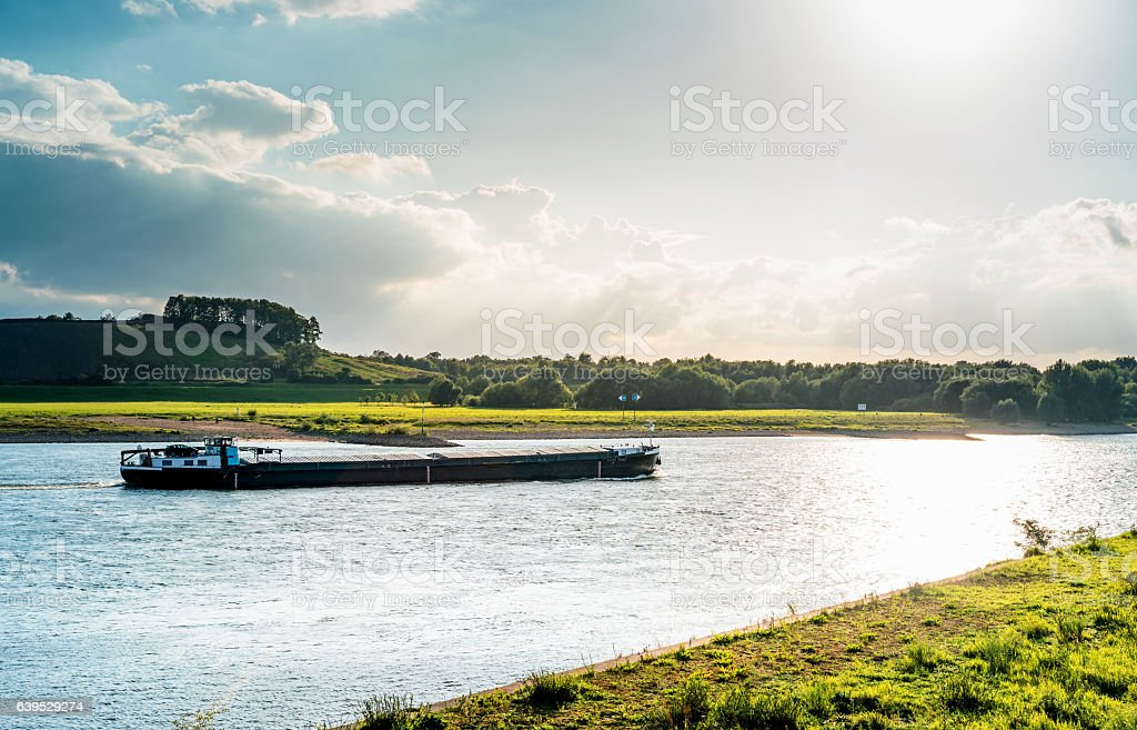 barge transports shipping travel along  Rhine river, Germany stock photo