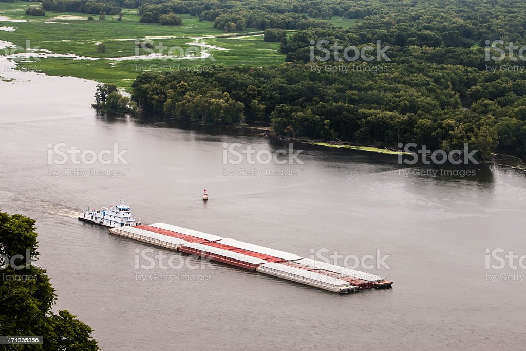 Barge with cargo on the Mississippi River stock photo