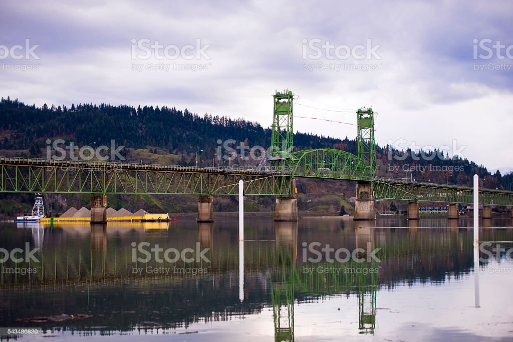 Barge with cargo on the river with a drawbridge stock photo