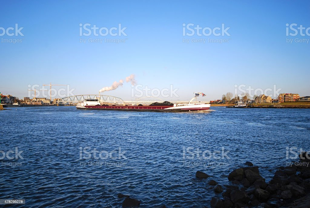Barge with stone Coal on river the Waal. stock photo