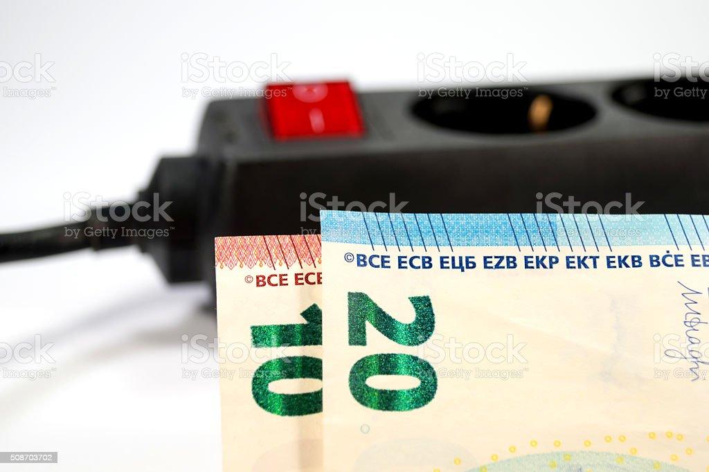 Bargeld und eine Stromleiste stock photo