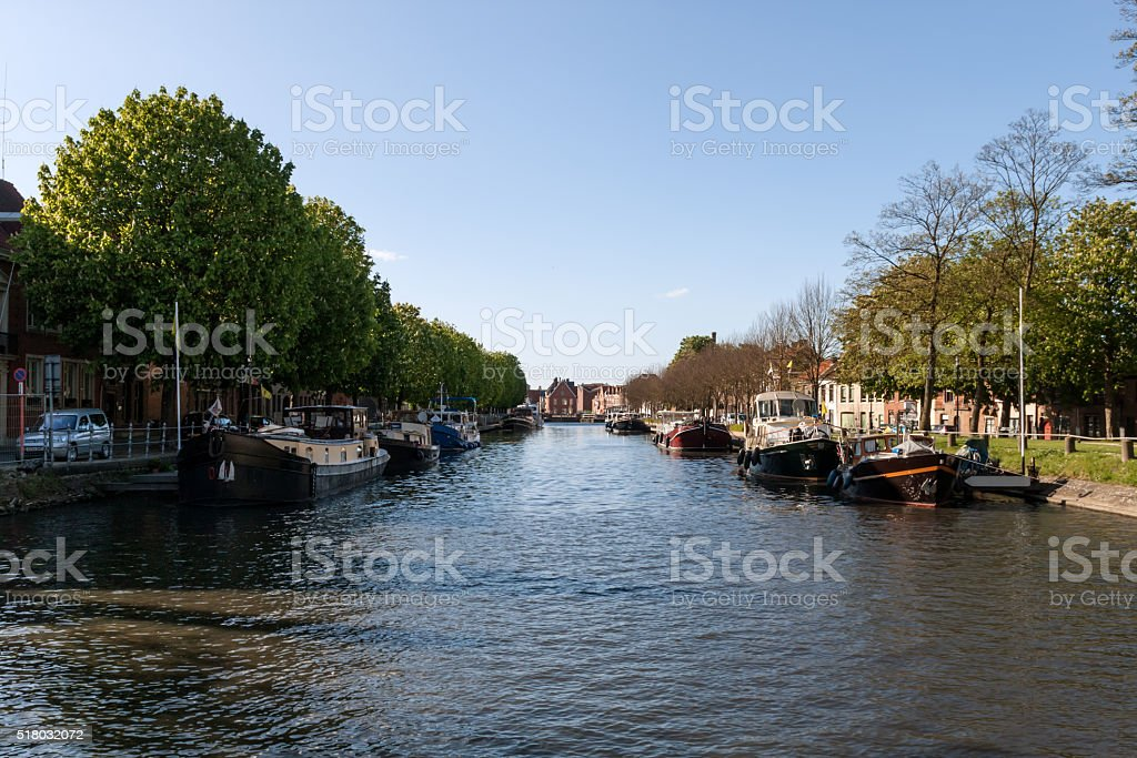 Barges and boat on the city channel stock photo