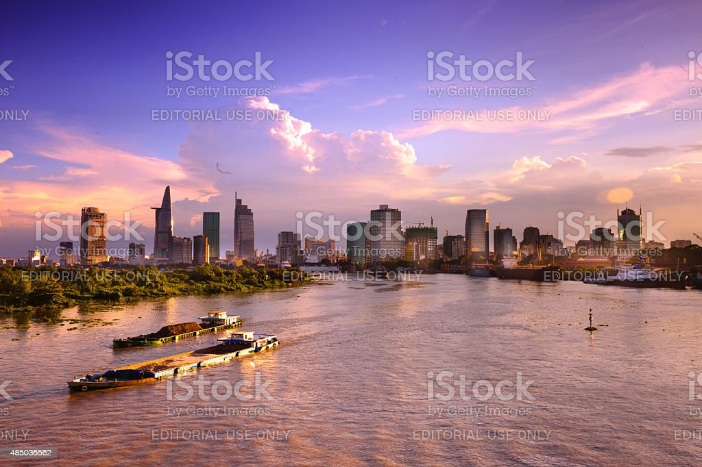 barges carrying sand on the Saigon River stock photo