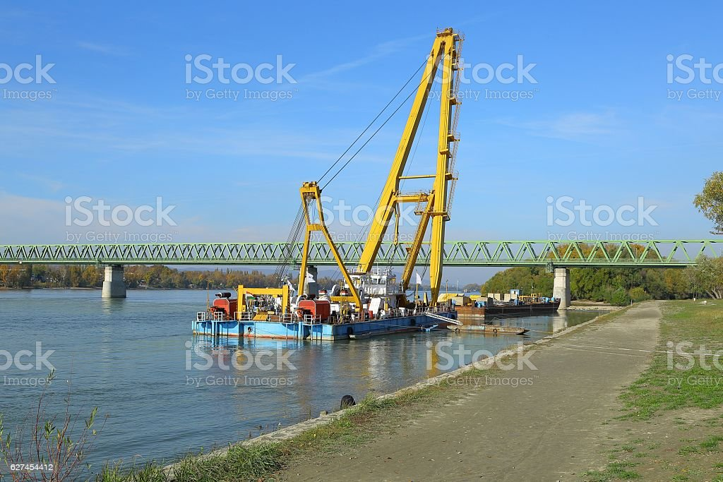 Barges with construction equipment stock photo