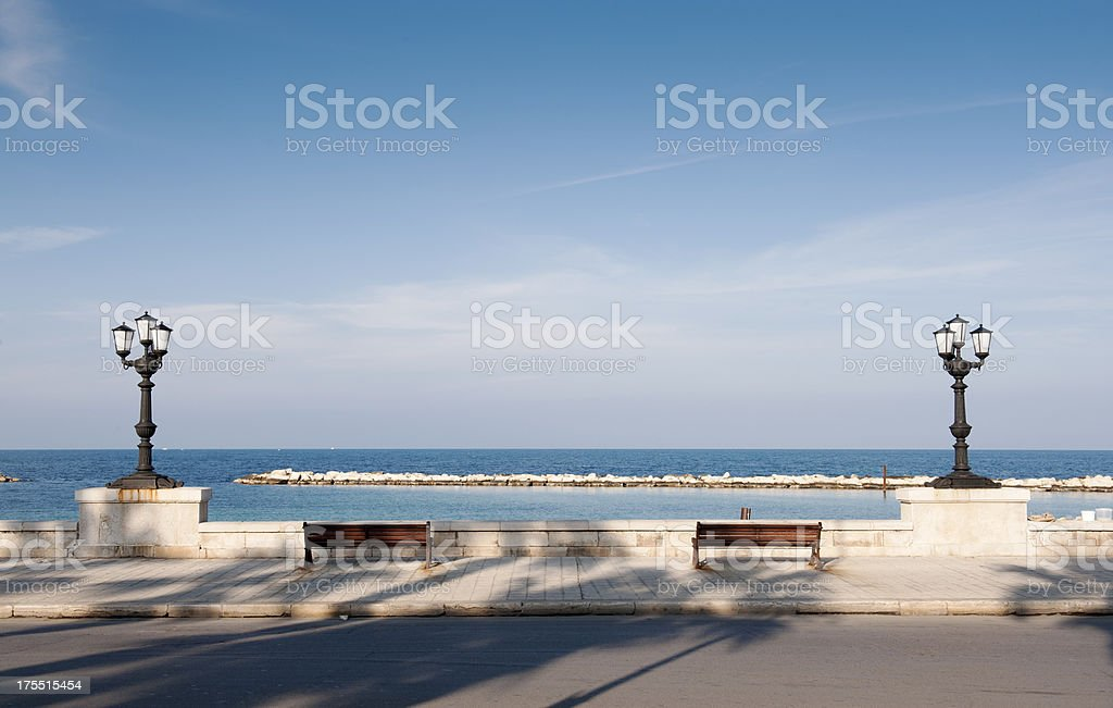 Bari, promenade with bench and lamppost. Apulia - Italy stock photo