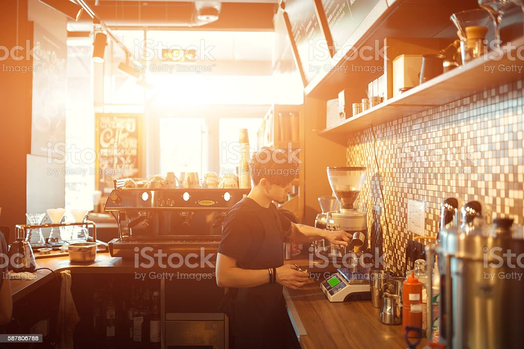 Barista at work in a coffee shop stock photo