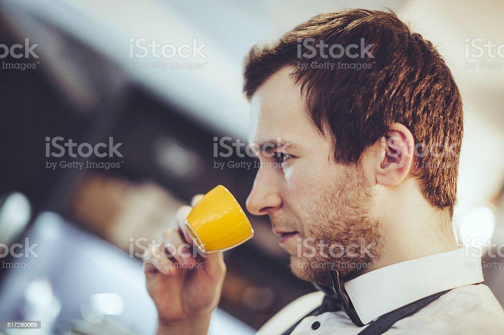 Barista is tasting an espresso stock photo