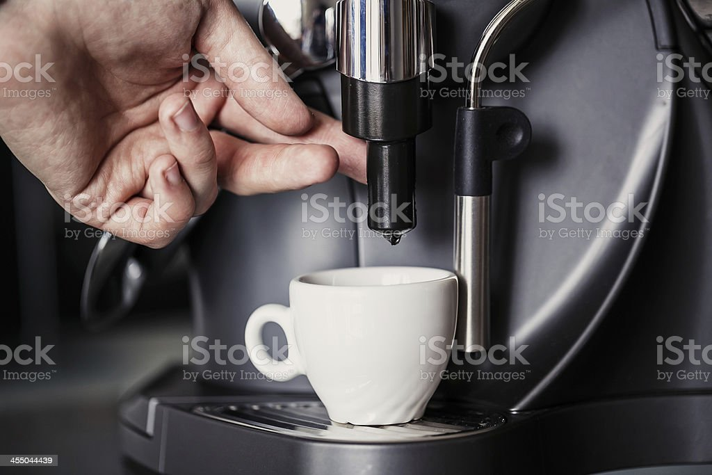 Barista makes coffee with a machine stock photo