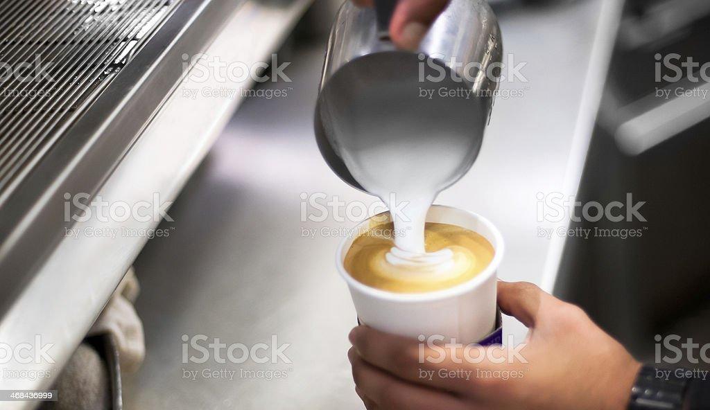 Barista making caffe latte. stock photo