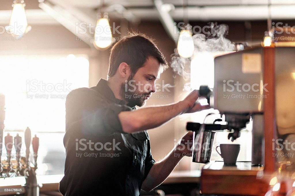 Barista making cappuccino stock photo