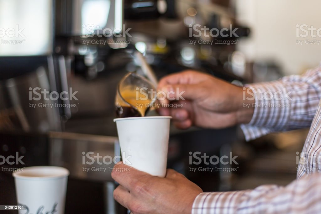 Barista making coffee stock photo
