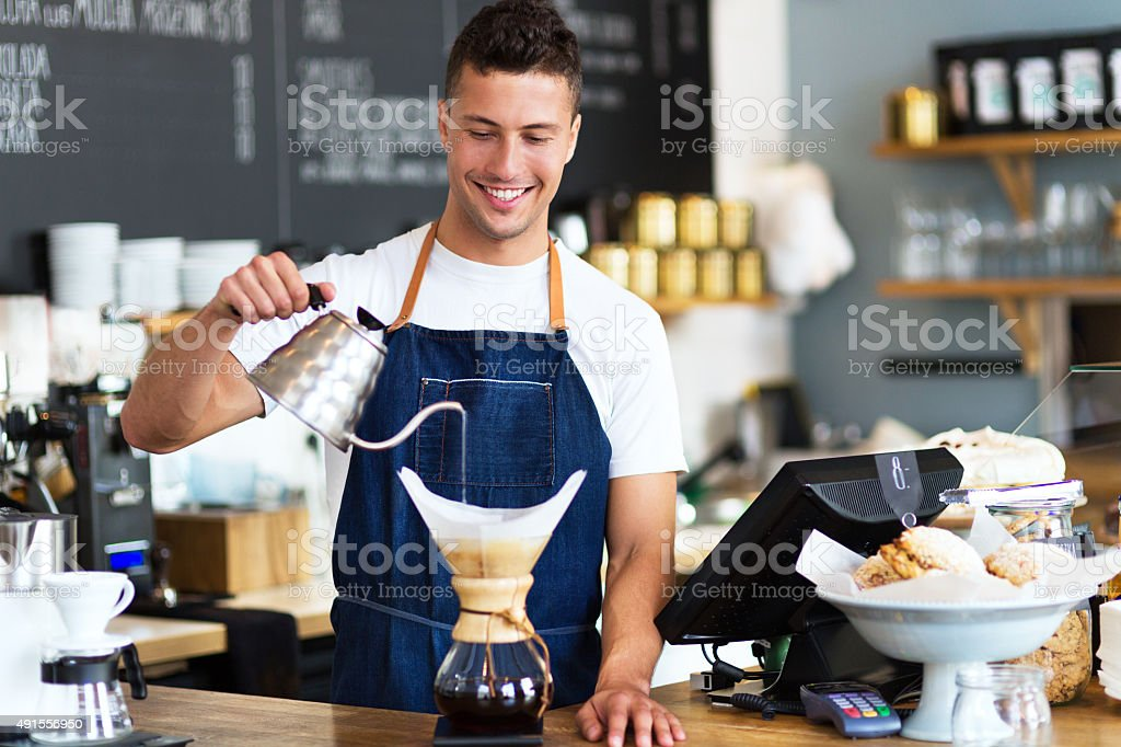 Barista making filter coffee stock photo