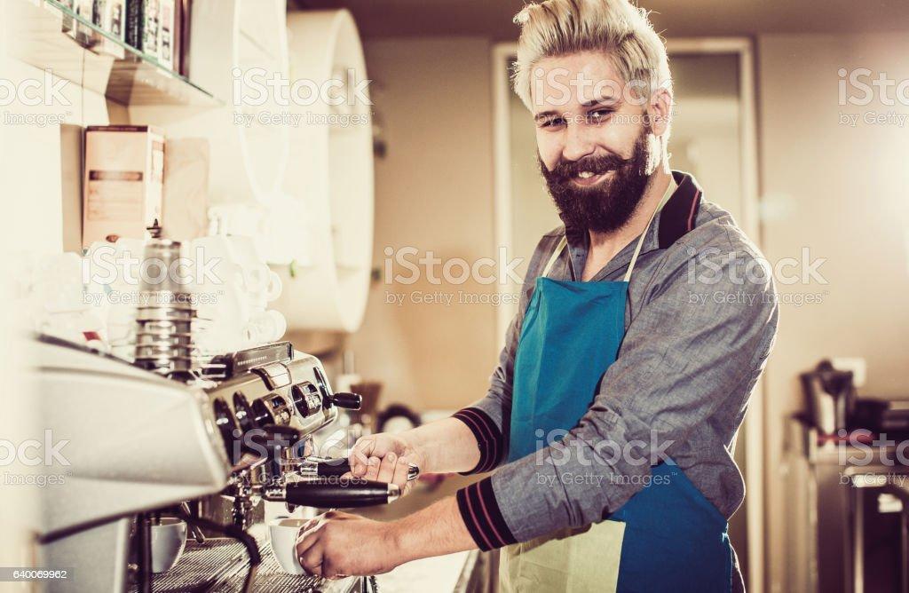Barista Making Fresh Cup of Coffee stock photo
