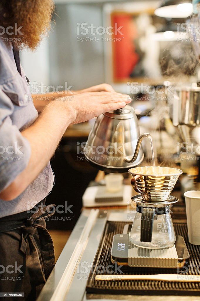 Barista making hand drip coffee stock photo
