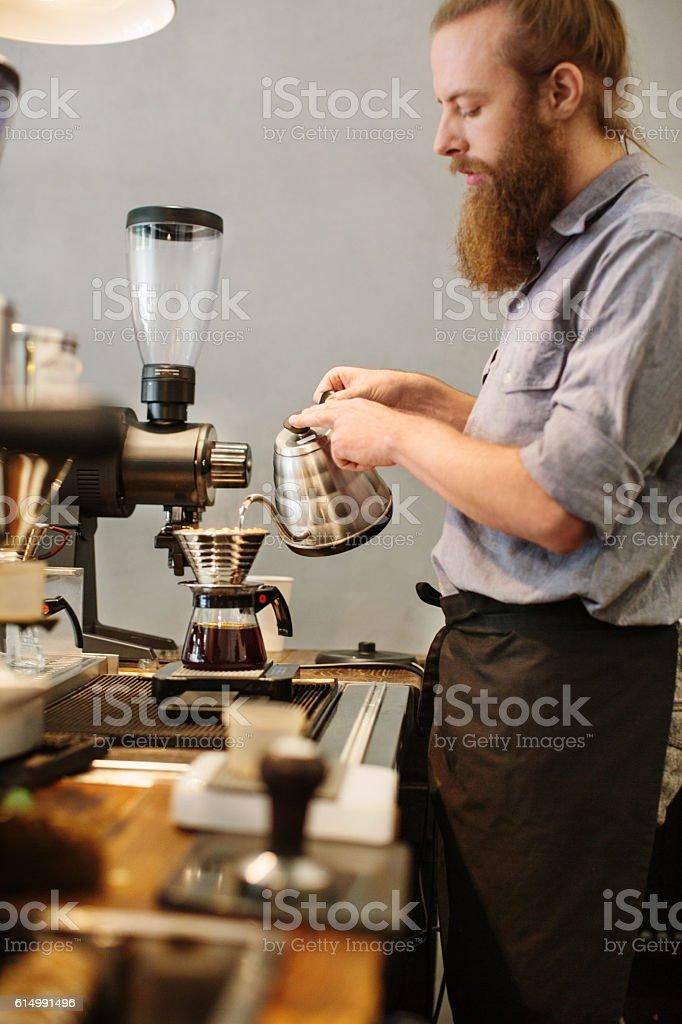 Barista making hand drip coffee stock photo
