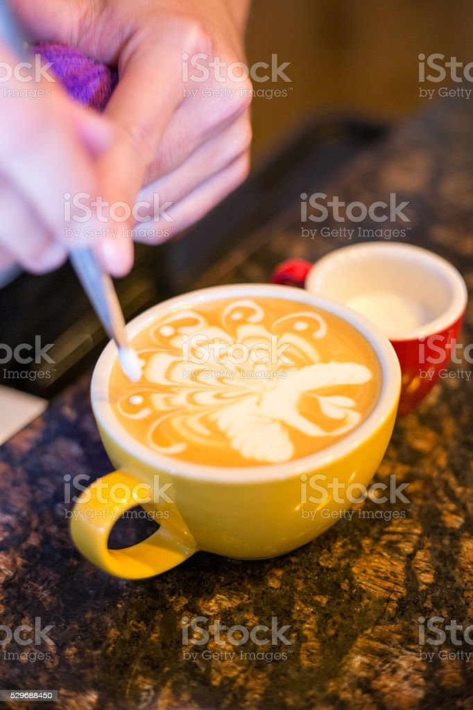 Barista Making Latte Froth Art stock photo