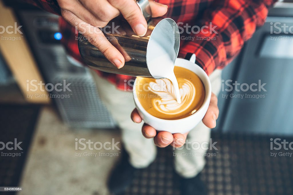 Barista Pouring Latte Art stock photo