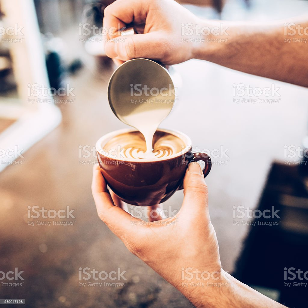 Barista Pouring Latte Froth Art stock photo