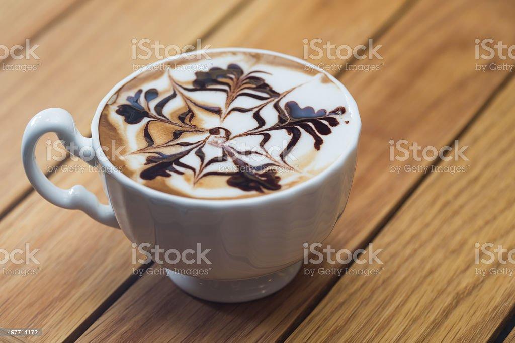 Barista pouring milk in capuccino coffee in coffeeshop stock photo