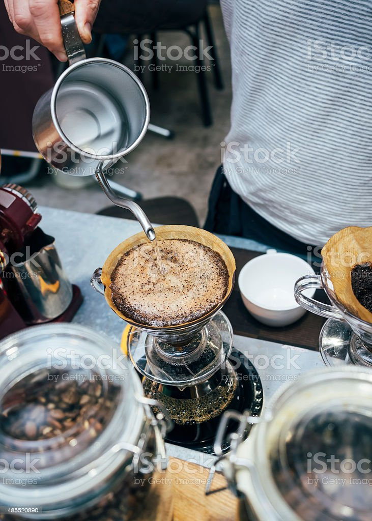 Barista pouring water on Drip coffee stock photo