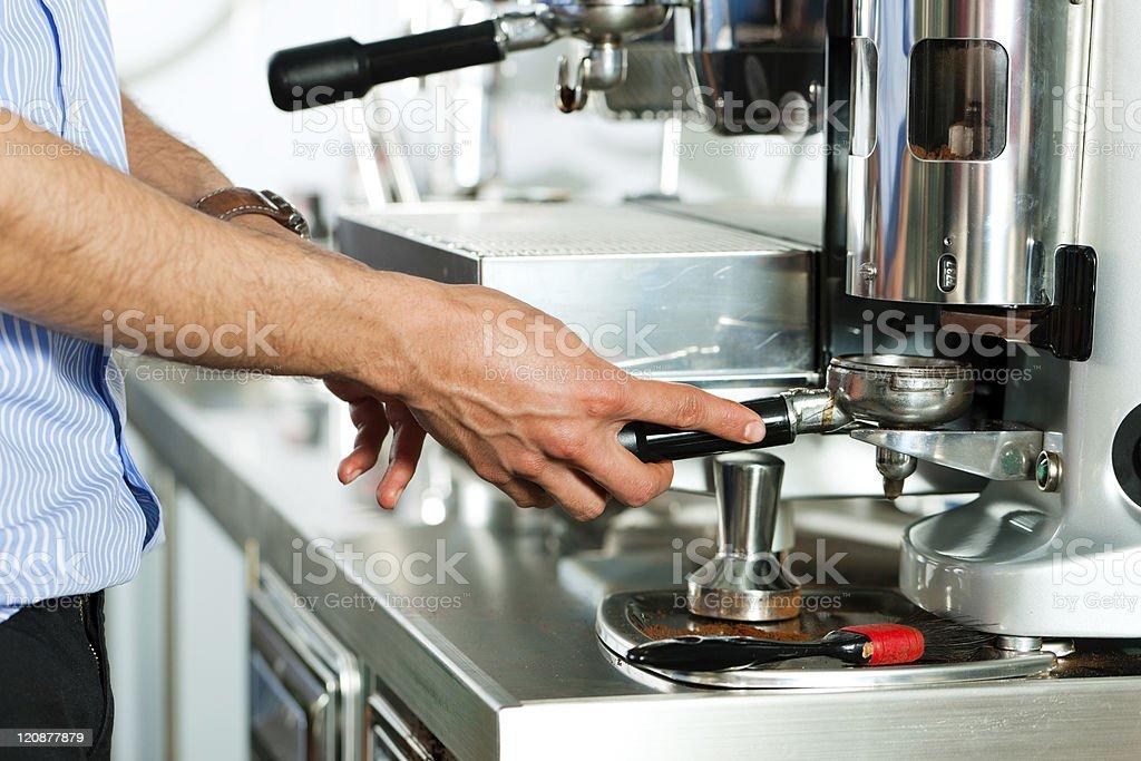 Barista prepares espresso royalty-free stock photo