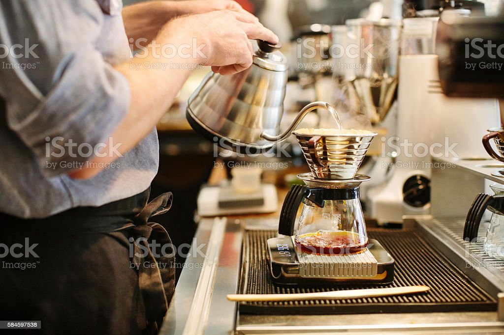 Barista preparing drip coffee stock photo