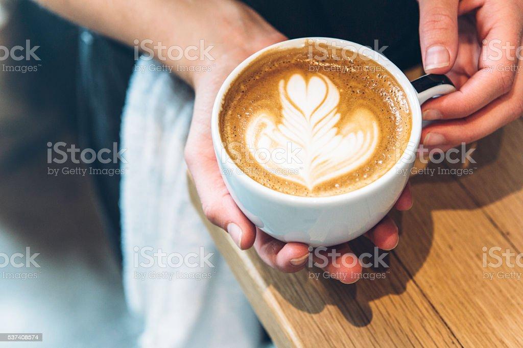 Barista Showing Latte Art stock photo