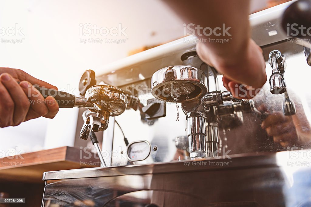 barista shows how coffee machine works stock photo