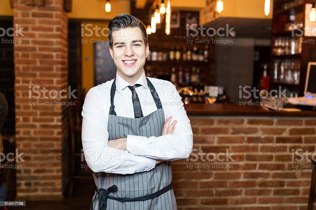 Barista smiling at the camera stock photo