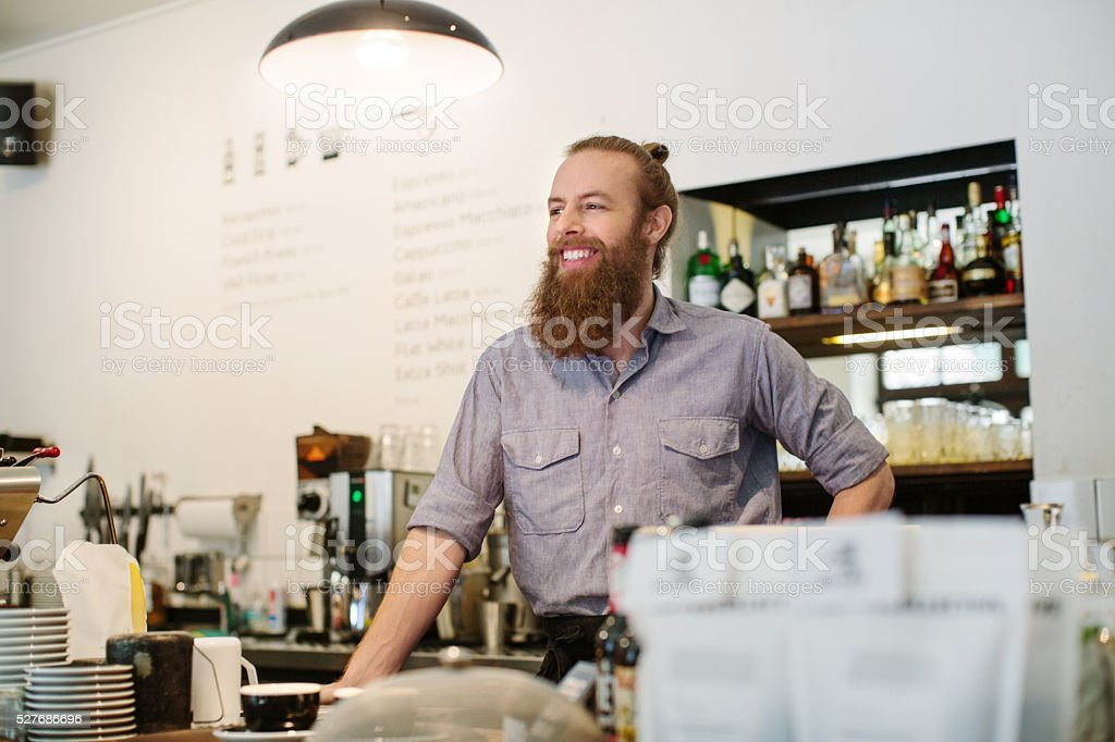 Barista standing at a coffee shop stock photo