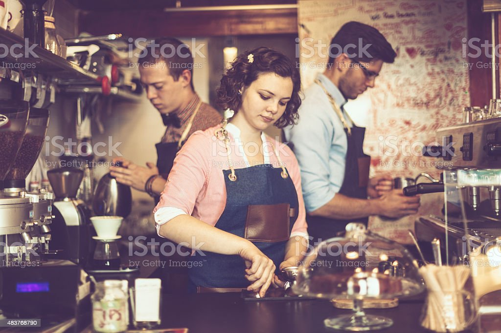 Barista team is working in a coffee shop stock photo