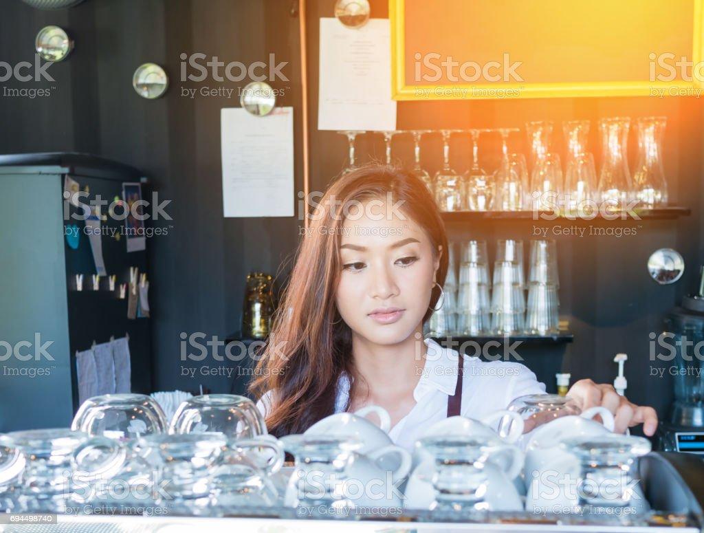 Barista using coffee machine in coffee shop counter stock photo
