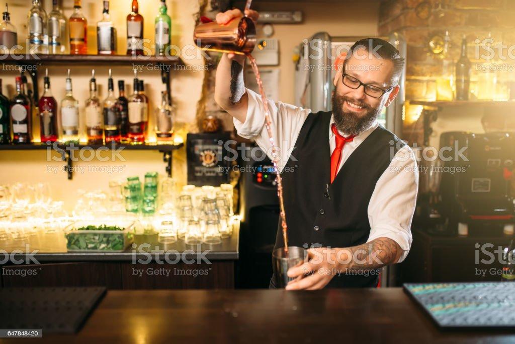 Barkeeper show behind restaurant bar counter stock photo