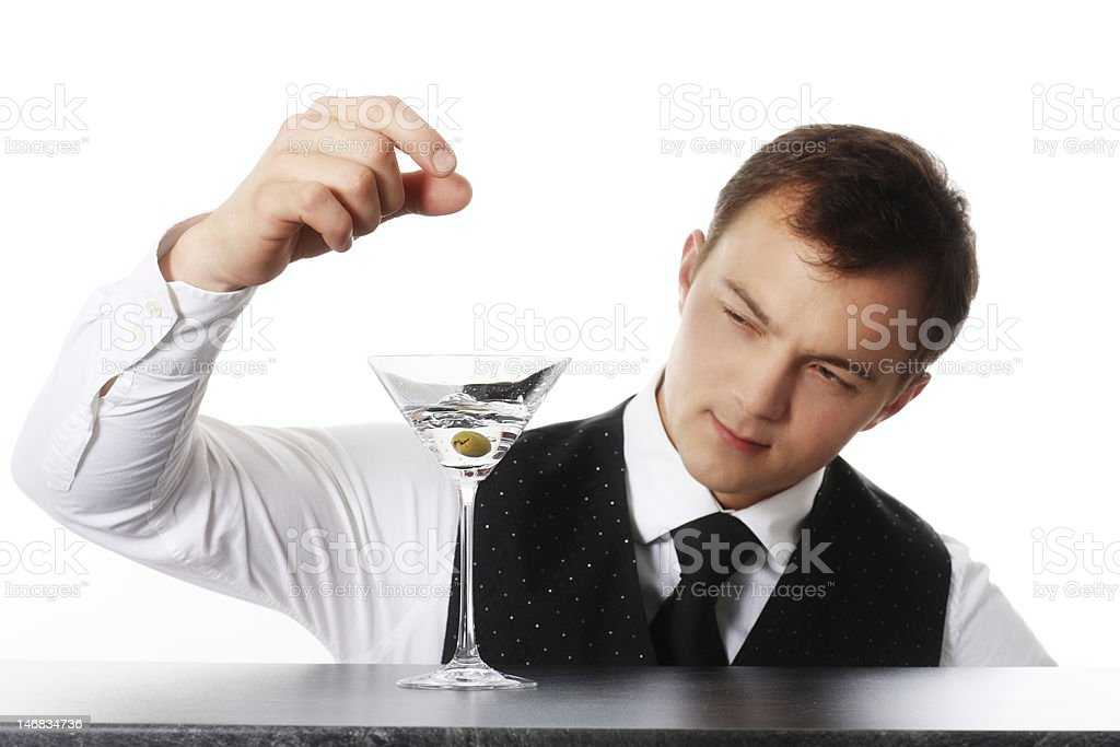 Barkeeper with Drink and Olive royalty-free stock photo