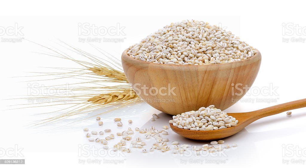 Barley Grains in the wood bowl  on white background stock photo