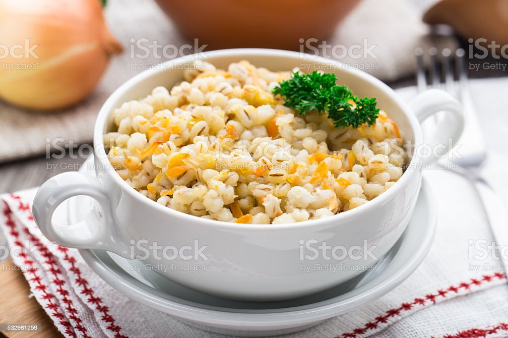 Barley porridge with carrot and onion stock photo