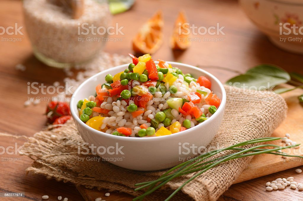 Barley salad and assorted vegetables stock photo