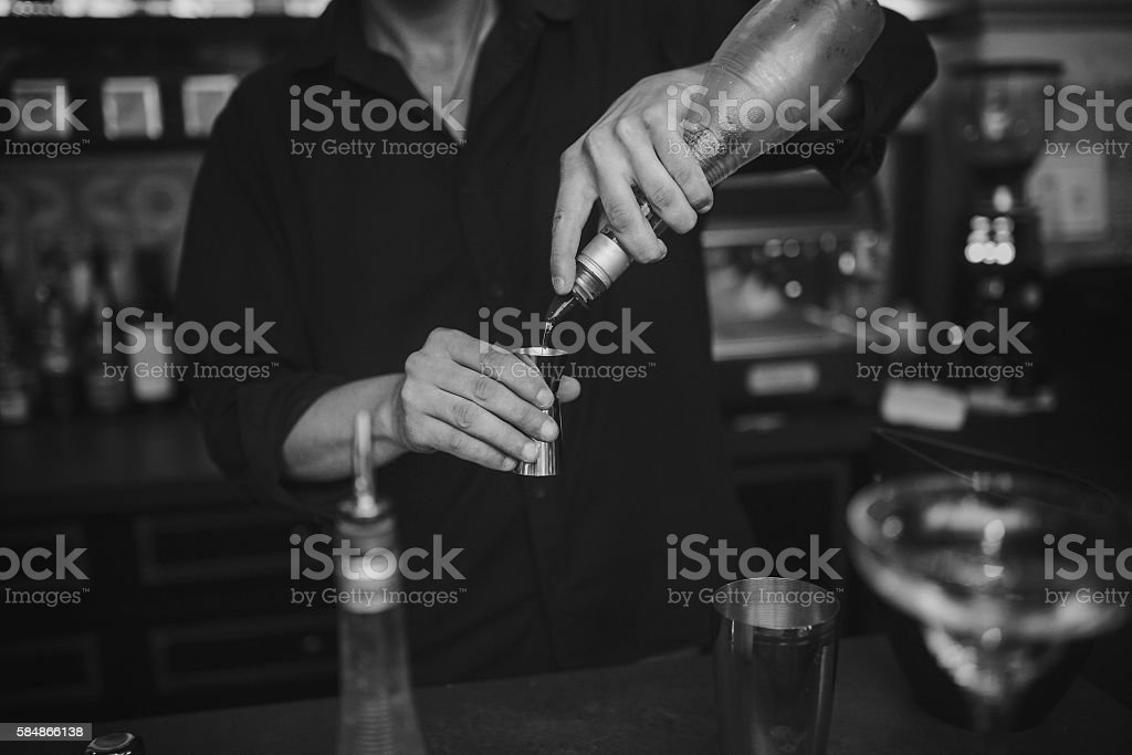 Barman at work in the pub stock photo