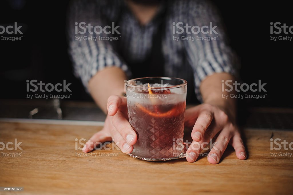 Barman at work, serving cocktails. stock photo