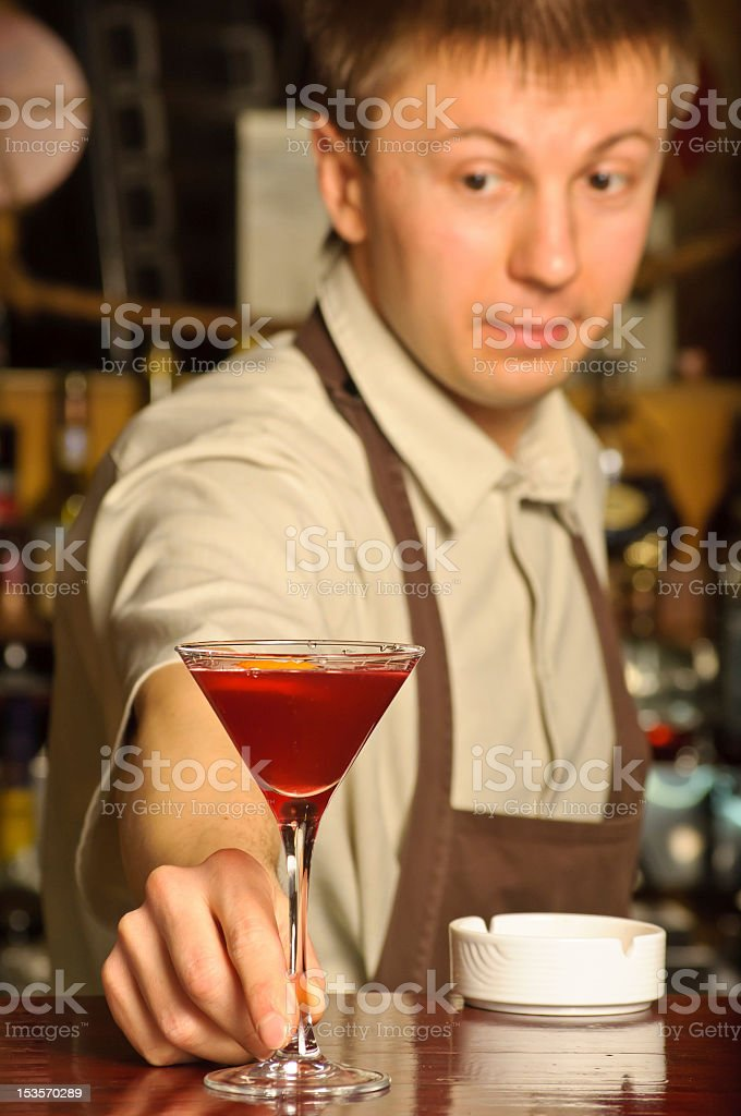 Barman holding the glass with cocktail royalty-free stock photo