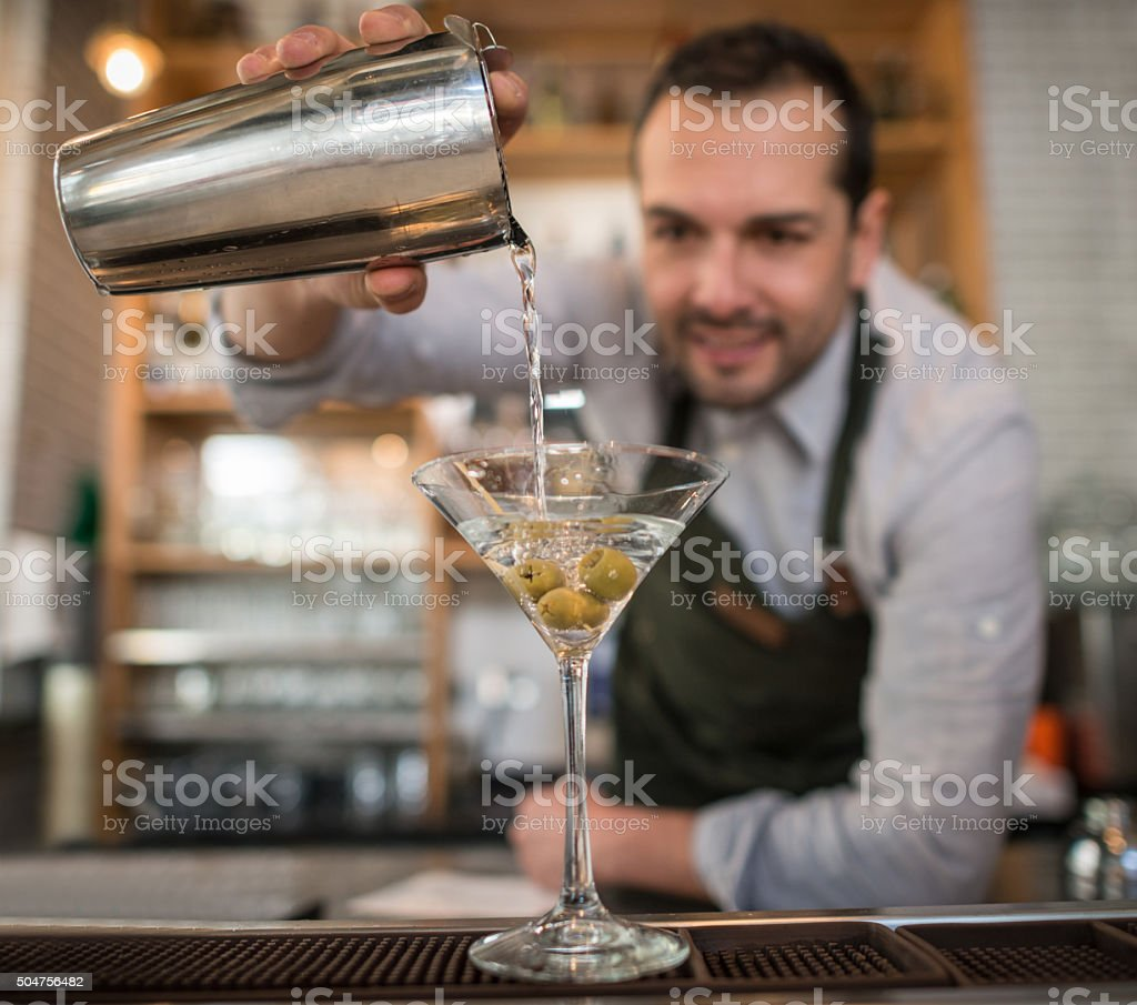 Barman making a martini cocktail stock photo