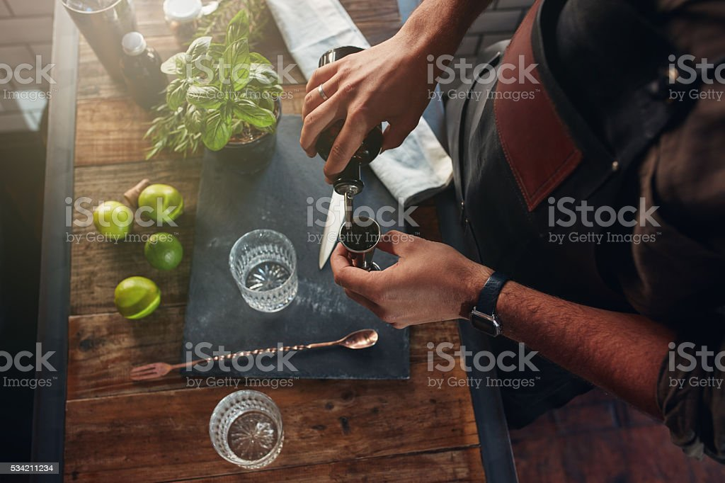 Barman making cocktail at the counter stock photo