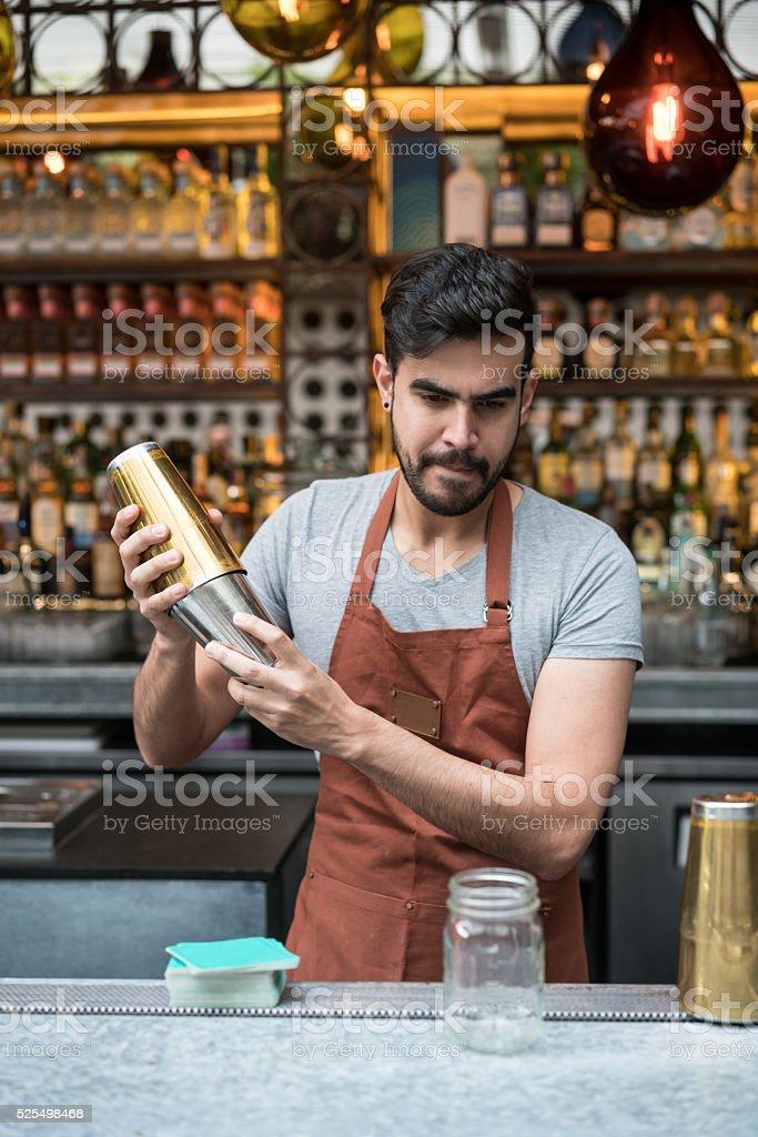 Barman making cocktails at a bar stock photo