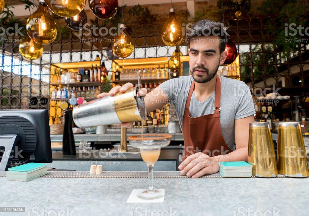 Barman making cocktails at the bar stock photo