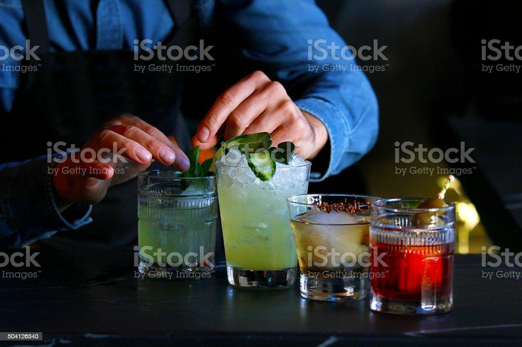 barman making cocktails stock photo