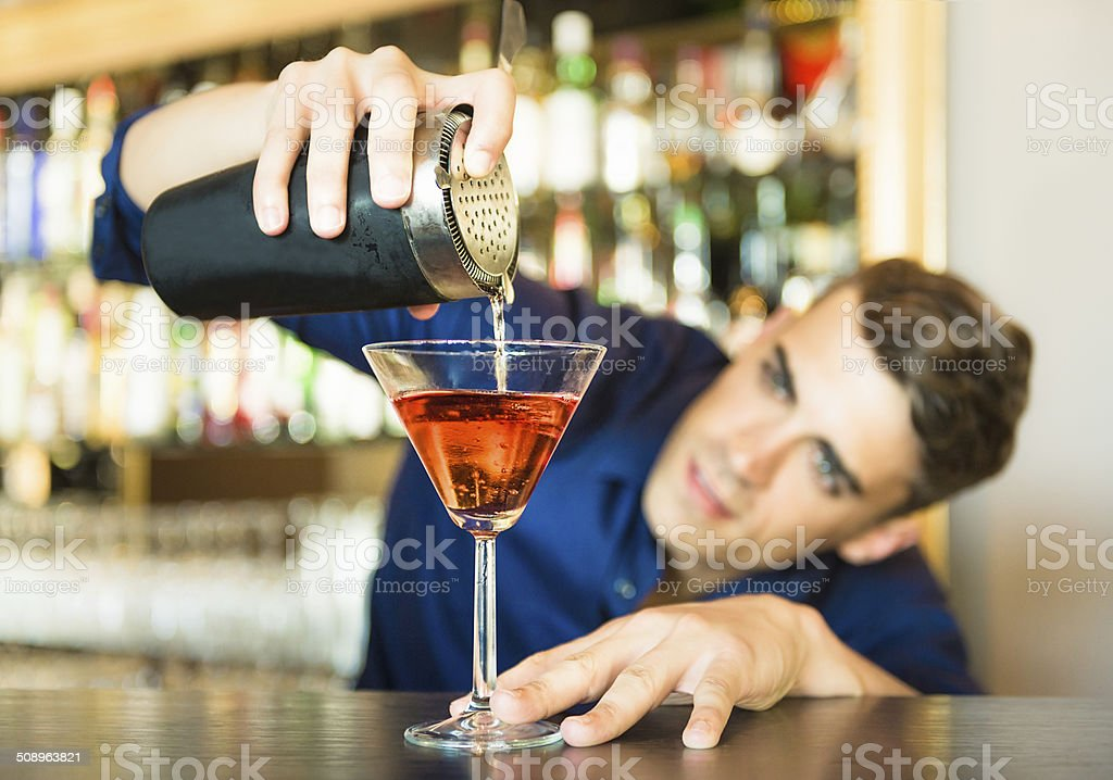 Barman pouring a cocktail stock photo